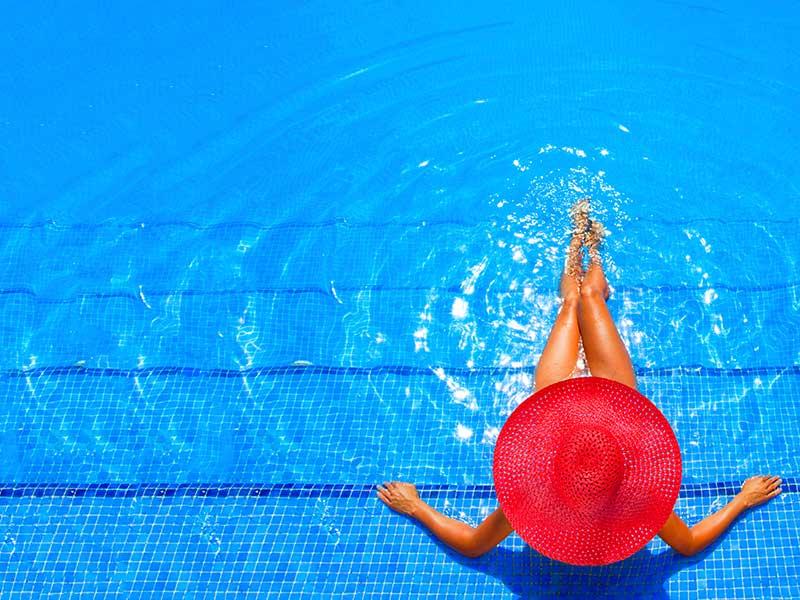 Woman on Pool Steps